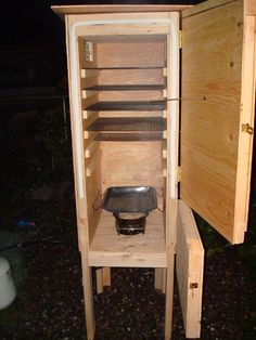 insulated plywood/propane smoker........versatile, could easily stick an electric element in there or use as a cold smoker with a little duct work.