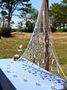 Hook #escortcards onto a fishing net for a #nautical style wedding. {@myweddingbelle}