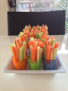 Individual hummus dip cups (shot glasses) with vege and bread sticks. #dip #hummus