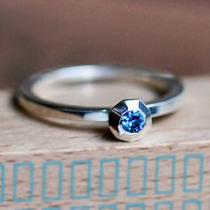 Sapphire engagement ring. I have seen these in person and they are unbeliveably gorgeous- really sparkle and are heavy and so unique.  One of my favorite Etsy jewlery makers!