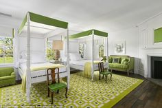 Green with envy: Another one of the ten bedrooms features green colored furniture and a gorgeous rug that helps to complete the large space