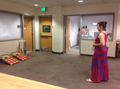 Librarian Ellie Dworak makes use of our newly opened space to play some lawn games