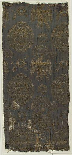 Textile Date: 14th century Culture: Italian Medium: Silk & metal thread Dimensions: Overall: 18 11/16 × 8 in. (47.5 × 20.3 cm) Storage: 25 1/2 × 13 in. (64.8 × 33 cm) Classification: Textiles-Woven