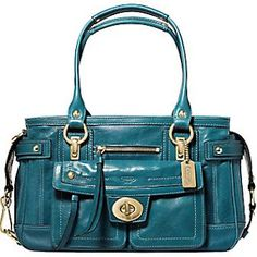 I own the matching wristlet, but I would die to get my hands on this gorgeous teal bag! Vintage Lindsay Leather Shopper by Coach in teal and brass