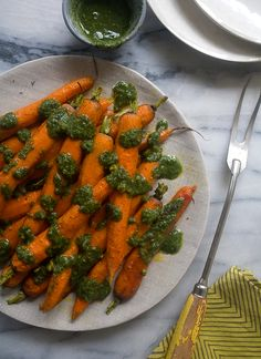 What a great way to use the whole carrot -   Roasted Ras El Hanout Carrots with Carrot-Top Pesto // www.acozykitchen.com