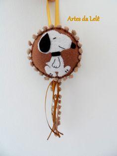 Pingente Snoopy.