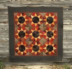 This block included in A Little Porch Time we did as a Block of the Month quilt. | love this star block -- looks like sunflowers! Great color combination!