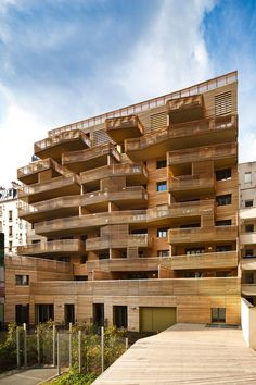 Apartment blocks in Paris with contrasting facades and angular balconies.