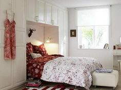 Great Ideas to Make Small Bedroom Looks More Spacious : A White And Red Themed Bedroom White Fit In Furniture Sets A Bed With Red Bedding And White Bed Cover A Wide Large Ottoman In The Bed Feet A White And Red Themed Area Rug A