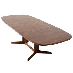 Danish Rosewood Dining Table With Organic Base And Two Extension Leaves   From a unique collection of antique and modern dining room tables at http://www.1stdibs.com/furniture/tables/dining-room-tables/