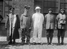 THEIR MAJESTIES VISIT MILITARY CLOTHING FACTORY (Q 30788)   Men apparelled in various uniforms to represent the army clothing supplied by them.