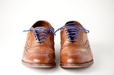 blue laces.. I really love this shoes ! Any rate this is a nice gift for my father-in-law !!