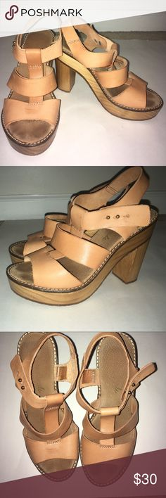 Free People Summer Sandals with Heel Worn a couple of times but no sign of wear. FEEE PEOPLE sandals with a little platform and heel in wood like material. Brown/tan straps and gold bottoms to fasten. Perfect for the summer to wear for a formal or causal event Free People Shoes Sandals