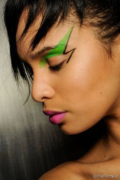 Channel your inner David Bowie with this graphic, colorful eye makeup.
