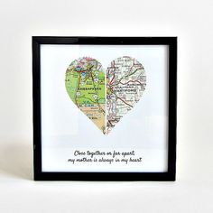 Choose a special town or city for each half of this vintage map heart and add a quote to make it a unique + personal holiday gift for long distance loved ones. Each half is hand-cut from a vintage map or atlas, mounted on archival quality fine art paper and framed in a 5 x 5 (12.7cm x 12.7cm) black frame. Frame can sit on a desk or shelf or hang on the wall. Locations and maps used are noted on a label on the back. Gift wrapping is available and includes wrapping, box and optional gift…