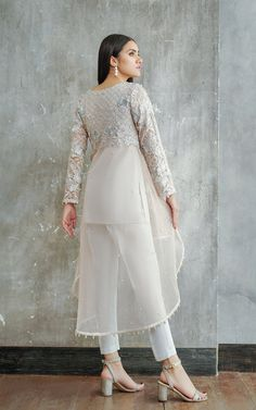 Front and sleeves net embroidered tail style shirt with embroidered yoke at back and pearls embellishments all around daman and sleeves. New Stylish Dress, Stylish Dress Designs, Designs For Dresses, Stylish Dresses, Dress Casual, Frock Fashion, Indian Fashion Dresses, Indian Designer Outfits, Fashion Outfits