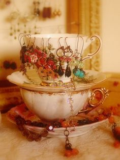 34 Ideas How To Store Your Jewelry | I love the idea of using vintage teacups and saucers to store jewelry!!