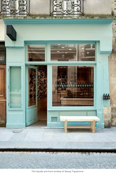 adorable aqua storefront .. would look great with the shop name in black cursive writing above the door :)