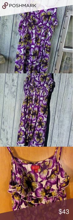ELLE ADJUSTABLE STRAP SUNDRESS SIZE L This ELLE sundress has adjustable spaghetti straps. I do have to say the pictures are a little decieving some of them show the color as blue & some shoe it as dark purple, no matter what lighting i tried to use it was not coming out the correct color. This dress is a bright purple floral design. It has ruffels at the top, & an elastic waist band. It has pockets on it as well. The dress is 26 inches long from top of bust area to hem. Remember I said the…