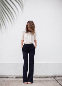 Work outfit. Silk blouse and elegant trousers. via Lilly and Leopard.