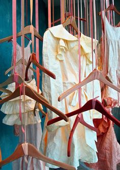 ribboned rain!  #hangers #dresses #feminine #pink #visualmerchandising #windowdisplay #propstyling #retail #exhibit #storewindows