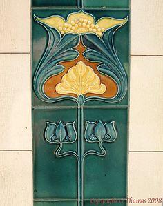 Art Nouveau tile panel outside a derelict butchers shop in North Wales. ~via Art Nouveau, Flickr