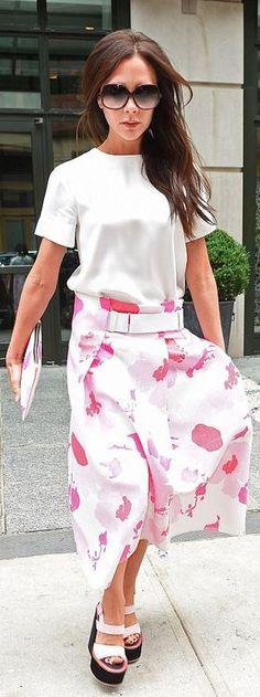 Victoria Beckham: Sunglasses – Cutler Purse and skirt – Victoria Beckham Collection