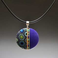 Polymer clay pendant - artist Meisha Barbee via Pismo Fine Art Glass