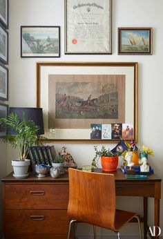 Opposite the bed, a small desk fits right up against the wall and in full view of the window. A framed degree—commemorating Gervasoni's grandfather matriculation from law school at the University of Virginia—was found, discarded, in the family basement | archdigest.com