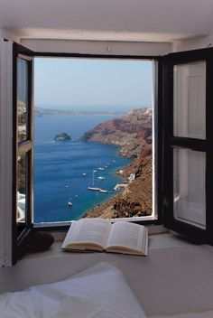 """City of Santorini in Greece. Santorini was formed by a series of volcanic eruptions. The island was once known as Stongili, which means """"round"""" in Greek. Beautiful World, Beautiful Places, Amazing Places, Haus Am See, Window View, Open Window, Through The Window, Santorini Greece, Santorini Island"""
