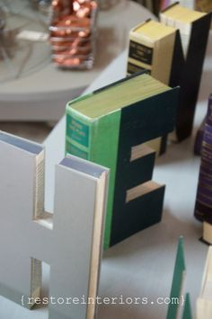 the thought of cutting a book {horrifies} me, but i LOVE these, regardless. (letter books) | restore interiors