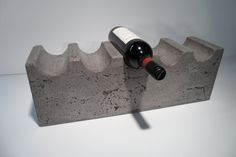 Concrete Wine rack. Imperfections in the finish make it look postindustrial. Can these semi-circles be made out of aluminium?
