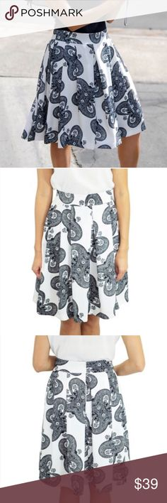 Gorgeous black and white paisley print swing skirt Beautiful swing skirt, perfect for the office or a date this summer! Hidden size zipper, fully lined. Looks awesome with a solid black top and heels 😍 Please refer to size chart. Based on feedback from buyers, I recommend ordering a size up (runs small). {BT2} Boutique Skirts