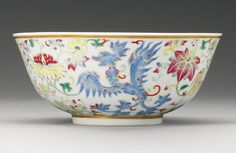 A FAMILLE-ROSE 'PHOENIX' BOWL GUANGXU MARK AND PERIOD the deep rounded sides rising from a straight foot, painted to the exterior in pink, yellow, and green enamels with four phoenix in flight amongst stylized lotus blooms, all set between a band of gilt around the mouth and foot, six-character mark in underglaze blue