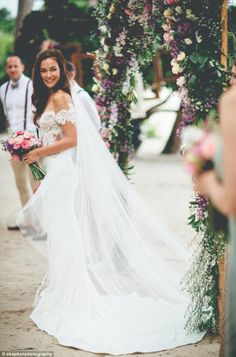 Stunning: Her white dress featured an off-the shoulder design and had embroidery on the bu...