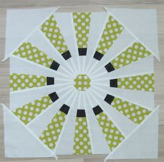 For every octagon we need 2 squares cut in half diagonally.The four triangles are stitched in four corners.I covered the center of the block with an octagon.Edited to add:Complete pattern available, if you want to sew your own version. Dresden Plate Patterns, Dresden Plate Quilts, Quilt Block Patterns, Pattern Blocks, Quilt Blocks, Quilting Tips, Quilting Tutorials, Quilting Projects, Quilting Designs