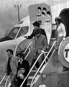 """ The Beatles on arrival at John F. Kennedy International Airport in New York, USA on August 13, 1965. They are led by Ringo Starr, left; and George Harrison; followed by John Lennon; and Paul McCartney. Behind is Gisa Kethe, Trans World Airlines stewardess who recently won the title of 1965 Miss New York Press Photographer. (AP Photo) "" Trans World Airlines - TWA - Trans World"