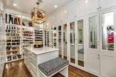 Contemporary Closet with Crown molding, Built-in bookshelf, Pendant Light, High ceiling, Hardwood floors