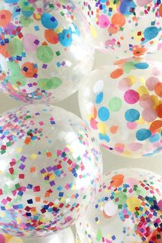fill balloons with confetti and string together for a balloon ceiling