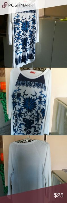 Designer Josie natori midi dress. This is a casual midi length dress. Can be worn as a beach cover or lounge dress at resort.  Great condition. White background with vibrant blue color flowers.  White back and long sleeve. Xlnt condition.  Bundle discount offered. Josie natori Dresses Midi