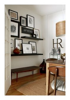 Love mixing shelf pictures with wall hung pictures.
