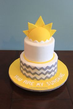 """""""You are my Sunshine"""" themed baby shower cake with custom-made sun cake topper and gray chevron pattern. Inside flavor was lemon with blueberry and cream cheese filling. Elephant Baby Shower Cake, Elephant Cakes, Grey Baby Shower, Baby Shower Cakes, Baby First Birthday Cake, Cake Baby, Sun Cake, Sunshine Birthday Parties, Sunshine Cake"""