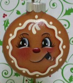 This little guy reminds us of days gone by when Granny used to make spicy ginger bread cookies to hang on the tree to decorate for that special day. Not many lasted all the way to Christmas but the memories will last forever. These are made of glass and are hand painted and are 2 1/2 inches round. They are great for the gingerbread collector in your life or just for an old fashioned Christmas look on your tree....Plenty of room on back if you want to have a name added for that personal…
