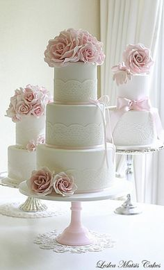 Weddbook is a content discovery engine mostly specialized on wedding concept. You can collect images, videos or articles you discovered  organize them, add your own ideas to your collections and share with other people | Three tier wedding cake with pink roses and lace.  The bride wanted to keep it simple - even though I tried my best to talk her into a few more roses.  I quite liked the look of it on my table with the other display cakes....