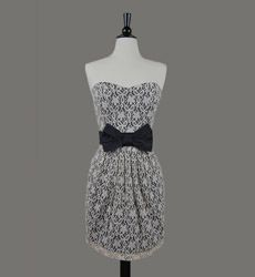 Love this dress, the simple black and white contrast is gorgeous and I love the black bow to finish it all off!