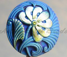 http://tophatter.com/auctions/15743?campaign=buyer_auction_reminder=email  Your bid is for one art glass button. I have a limited supply of these on hand right now. My small order arrived but I'm still waiting on my larger order.   @Tophatter