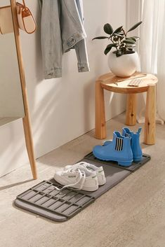 Entryway Shoe Drying Rack | Urban Outfitters Shoe Organizer Entryway, Entryway Organization, Wall Shelves, Shelving, Apartment Essentials, Apartment Ideas, Shower Accessories, Rubber Mat, Particle Board