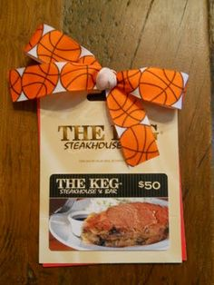 Cute thanks coach gift card idea. It's really this simple--get a gift card and tie a basketball ribbon to it. I'd probably tie this to a new clipboard.