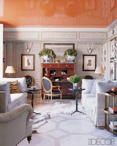 Jeffrey Bilhuber high gloss orange celing and studded walls..yes please