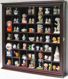 Collectible Display Case Wall Curio Cabinet Shadow Box, with glass door, CDSC03-CH by DisplayGifts. $99.95. Crafted from solid wood. No assembly required, comes in one piece. Felt Interior Background. Real Glass door to Protect and prevent dust, easy access. Wall Mountable, see dimensions in description. This display case has 41 individual slots for each item. A great way to display small curio, figurines, rocks or other miniatures. Black Felt background to create a l...